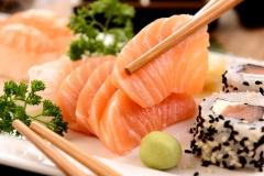Sashimi and sushi on white plate